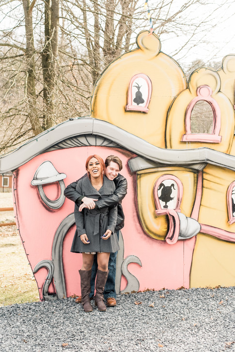 Couple having fun at a Grinch exhibit at a zoo