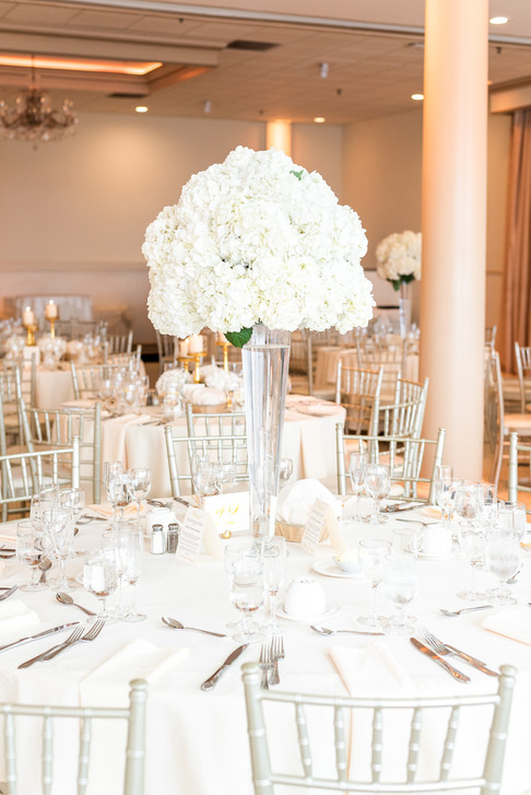 Floral centerpiece by Mayuri's Floral Design at the Greentree Country Club