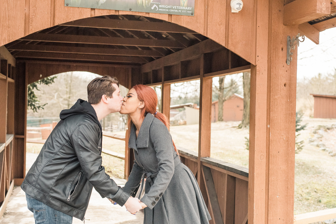 Romantic image of a couple kissing under a bridge in PA