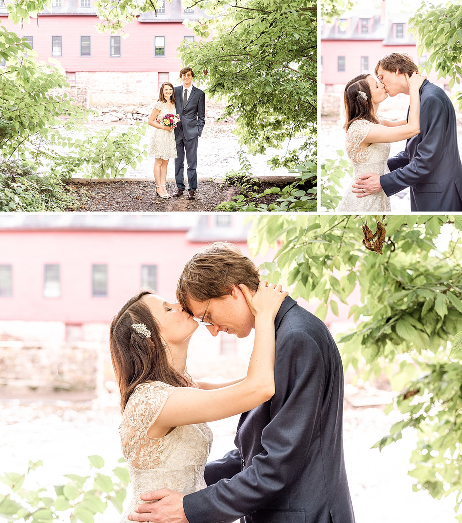Husband and wife kissing by the water in a park