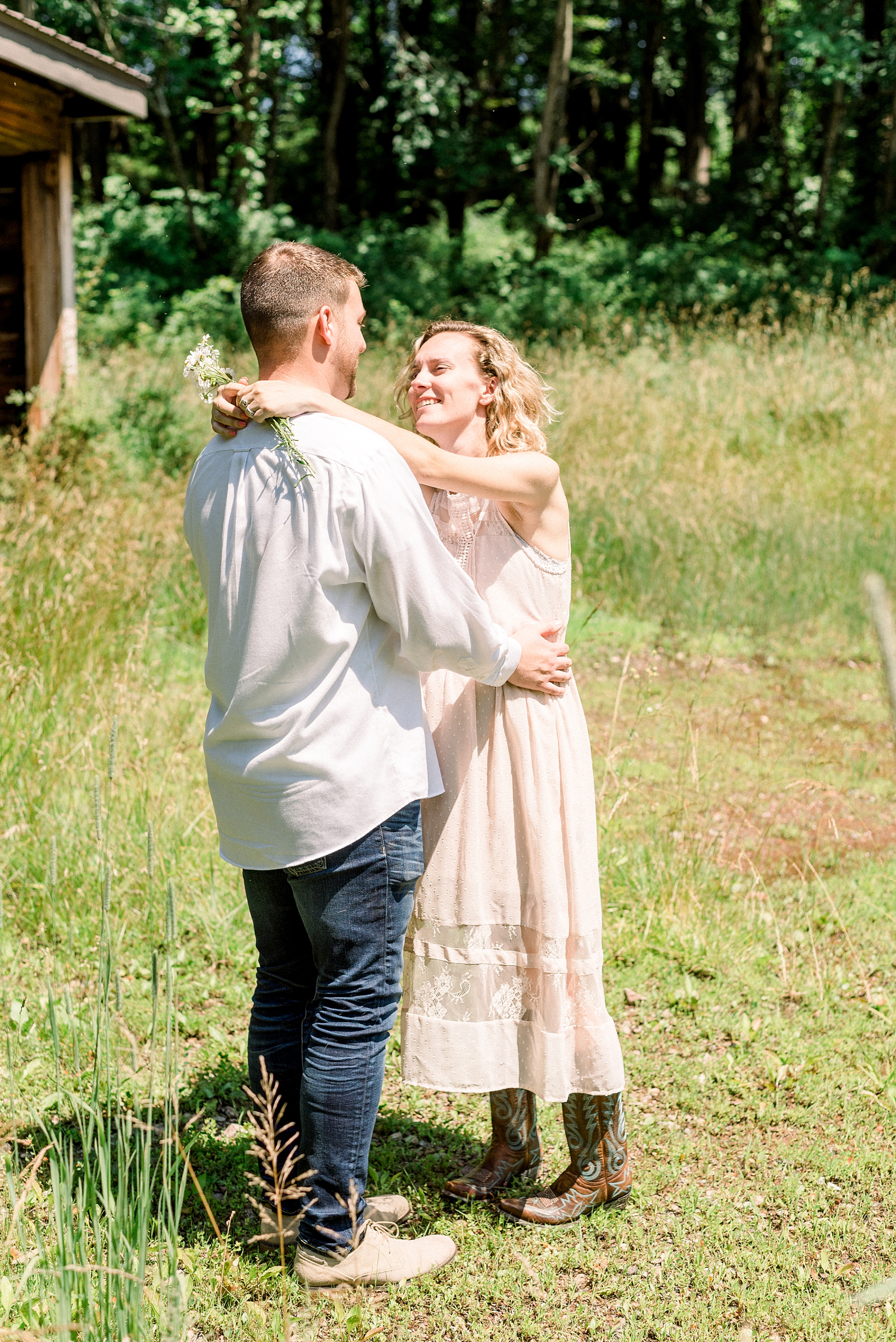 Cute couple dancing on a farm in New Jersey