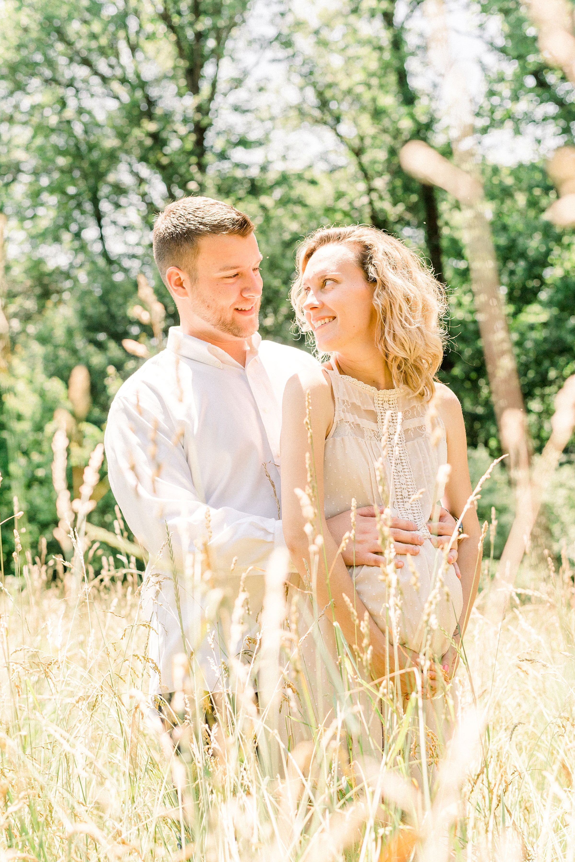 Couple in love during a maternity session on a farm