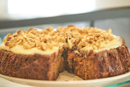 food photography of carrot cake with walnuts at Cafe Pure in Plettenberg Bay, South Africa by Naima Maleika