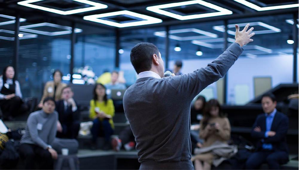 Man giving a meeting welcome speech
