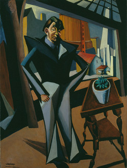 Man Standing at a Window
