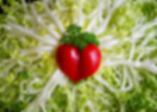 frisee salad with heart shaped tomato
