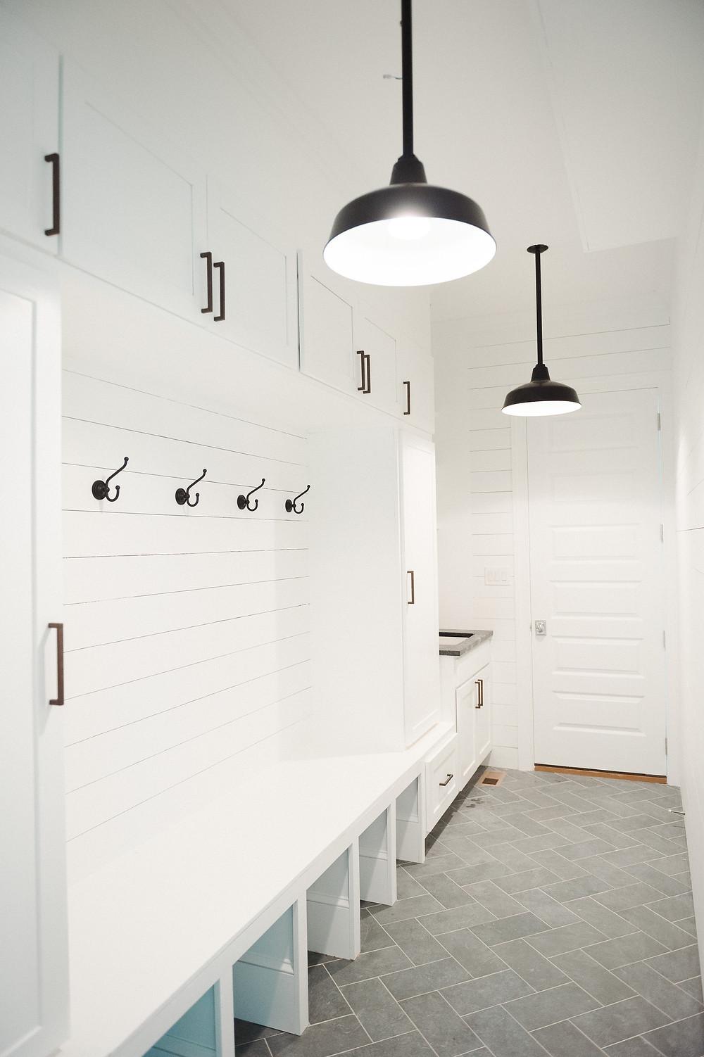 white mudroom, modern farmhouse, black light fixture