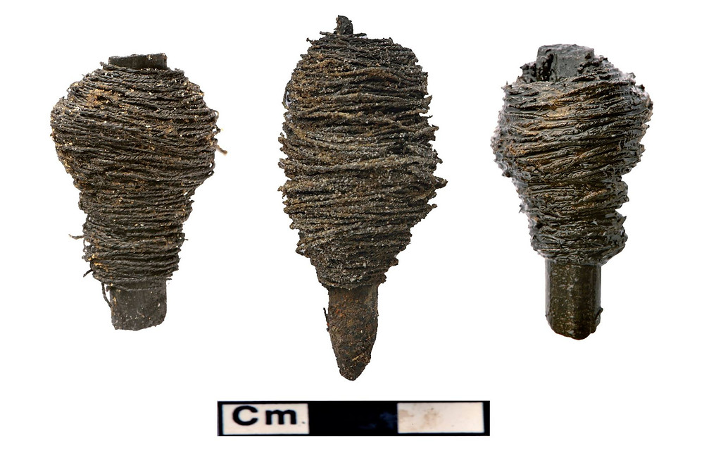 Three amazing bobbins wrapped in thread found at the Must Farm dig. They are all in absolutely fantastic condition.
