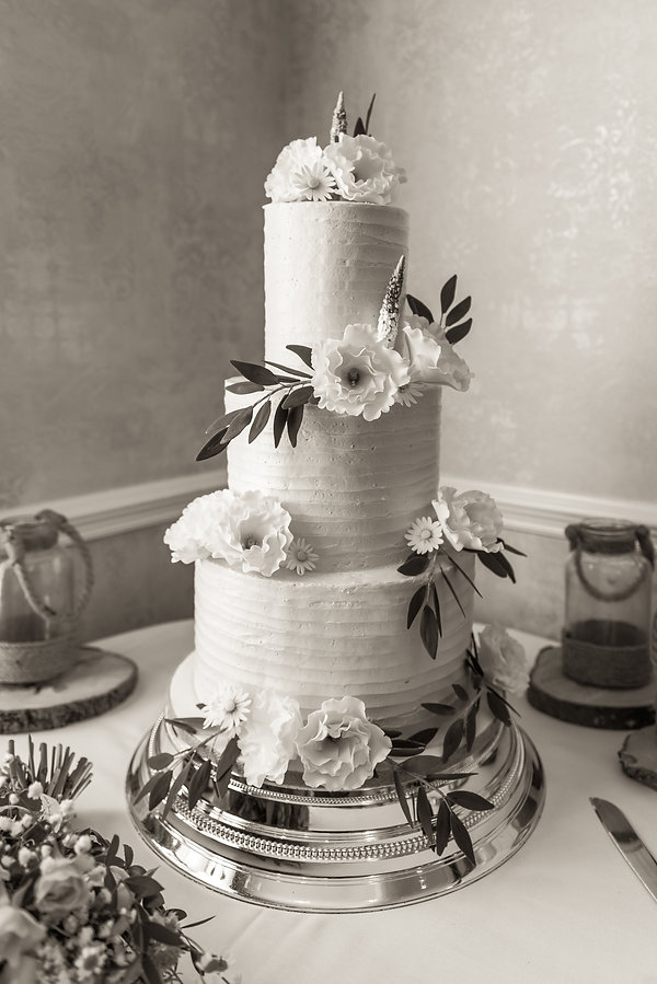Three tier wedding cake decorated with w