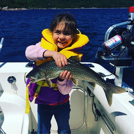 First fish of the day! Megan caught a nice sized laker using a watermelon spoon. Now she can enter the fish derby.jpg
