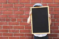 kid-with-blank-chalkboard.jpg