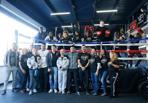 Dmitry Bivol and Kids from Faith Fighters International Photo Credit: Craig Bennett/Main Events