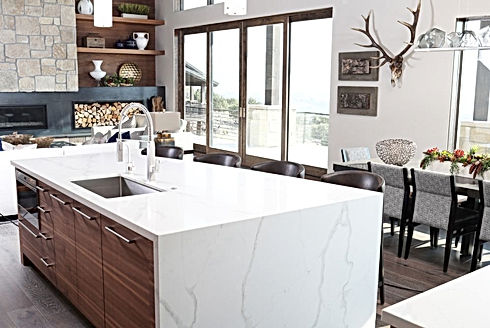 Rustic contempory kitchen with waterfall quartz island