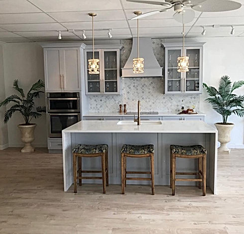Custom gray kitchen with waterfall island