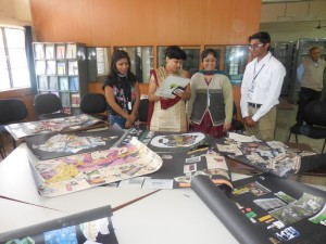 Ms. Anagha Kalay, Director, English Language Academy judging the Collage Competition