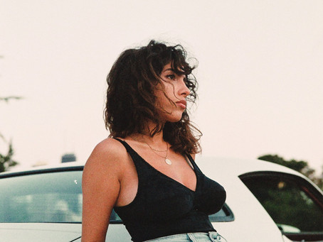 "Neena Roe Goes to the Beach in New Music Video for ""So Far"""