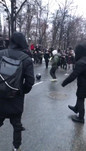 Protestors playing football with OMON's helmet