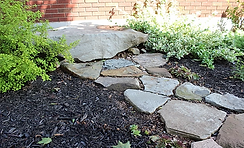 Rock bench with rock path.webp