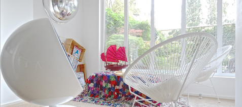 "Eero Aarnio ""Ball chair"", Acapulco chairs, Morrocan rugs, ""Ball"" wall art  & ""Junk"" chinese boat."