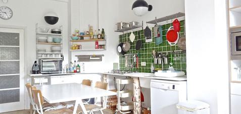 "Kitchen designed by architect Julien Legros, Ronan & Erwan Bouroullec ""Baguette"" dining table, vintage chairs & 70's lamps."