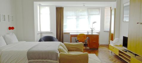 "Wardrobe design by architect Julien Legros, wall painting belgian artist Johann Damoiseau, vintage Sabena bureau & 80's chair. Gaetano Pesche ""UP"" chair."