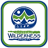 Very nice logo in greens and blues representing the sky, mountains and lakes of Vancouver Island.  Accessible Wilderess Society in the middle