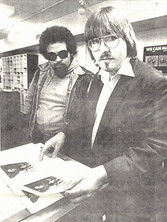 Mr. Blues, with sunglasses, and Jeff JJ Lisk, both musicians, copy fliers for an upcoming concert. 1986