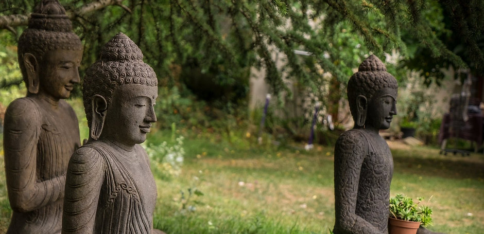 3+Buddha+statues+sitting_by+Paul+Davis.j