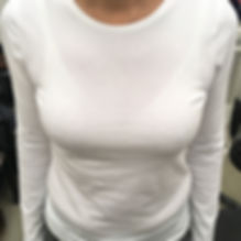 Close up of a woman in a white sweater.