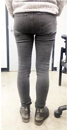 Woman seen from the back in jeans who ha