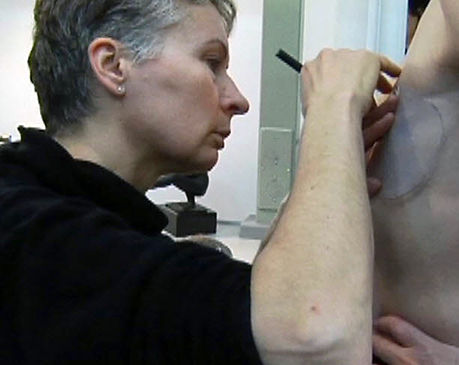 Anaplastologist working with a patient for a New Attitude custom breast prosthesis.