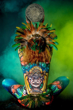 bodypaint Aztec culture headdress with feathers and gold