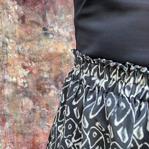 Jupe midi imprimé géométrique en plongé de soie noir et blanc Merida