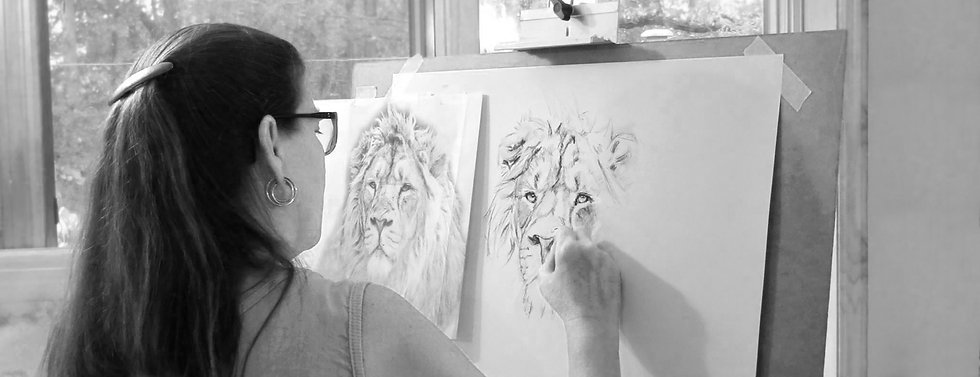 Stephie Butler drawing a lion in charcoal