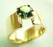 hand made solid gold and sapphire ring