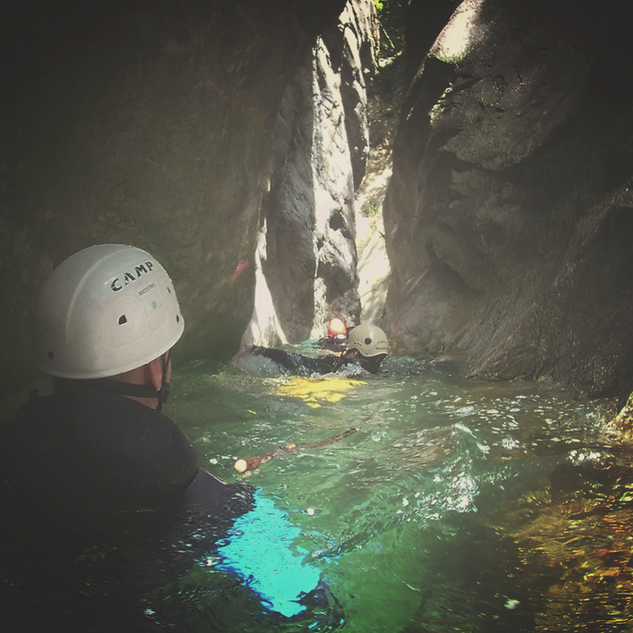 Narrow swimming during a canyoning trip