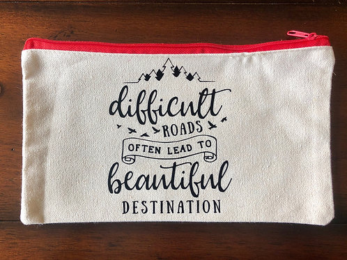 """Difficult roads often lead to beautiful destinations"" Travel Pouch"