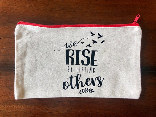 """We Rise By Lifting Others"" Travel Pouch"