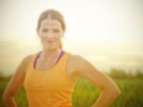 Smiling Female Jogger at Sunset (intenti