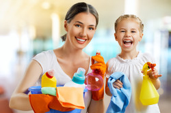 Mother and Dauther with cleaning bottles-215590489