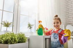 girl smiling and cleaning-384513559