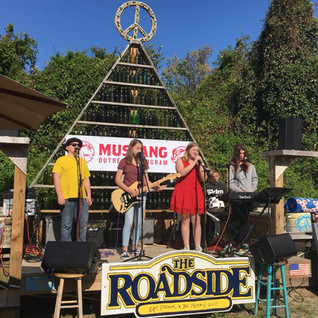 Mustang Outrech Program Students Performing The Roadside in Duck