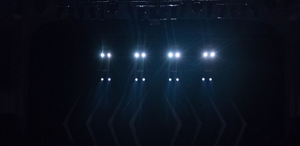 dark stage with stage lights