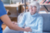 A GlobalCares home attendant helps an elderly patient