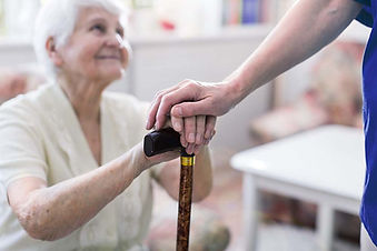GlobalCare Careworker helps an elderly patient with her walking stick