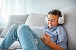A boy watches a Simply Spanish video on his laptop