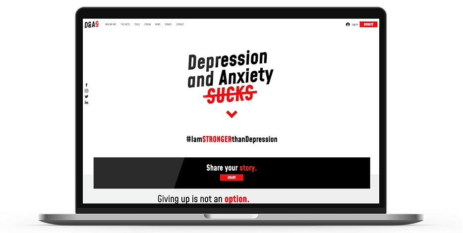 Laptop display of website for Depression & Anxiety Sucks