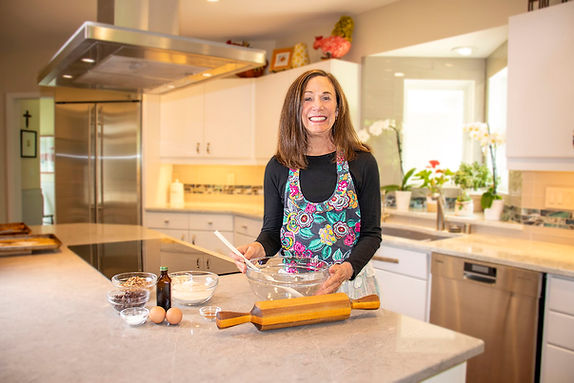 Julie DeLeeuw baking Julie's Blue Ribbon Cookies in her kitchen