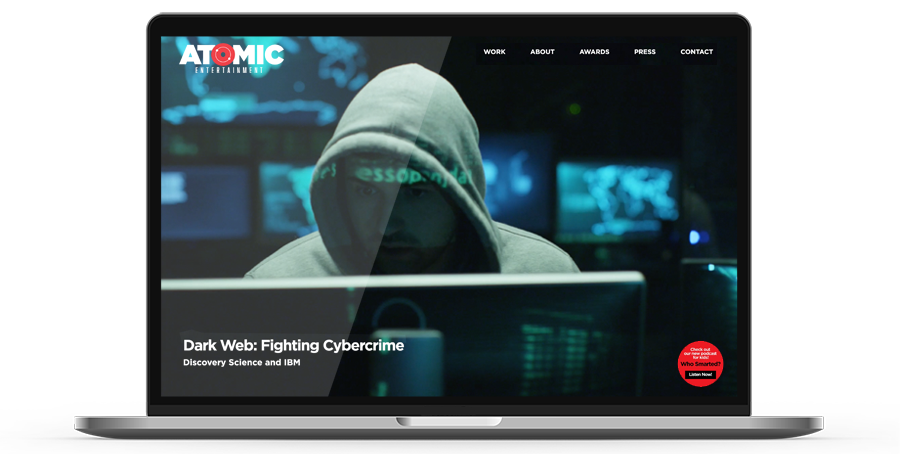 Laptop display of website for Atomic Entertainment