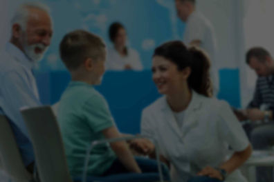 An international nurse talks to a young patient